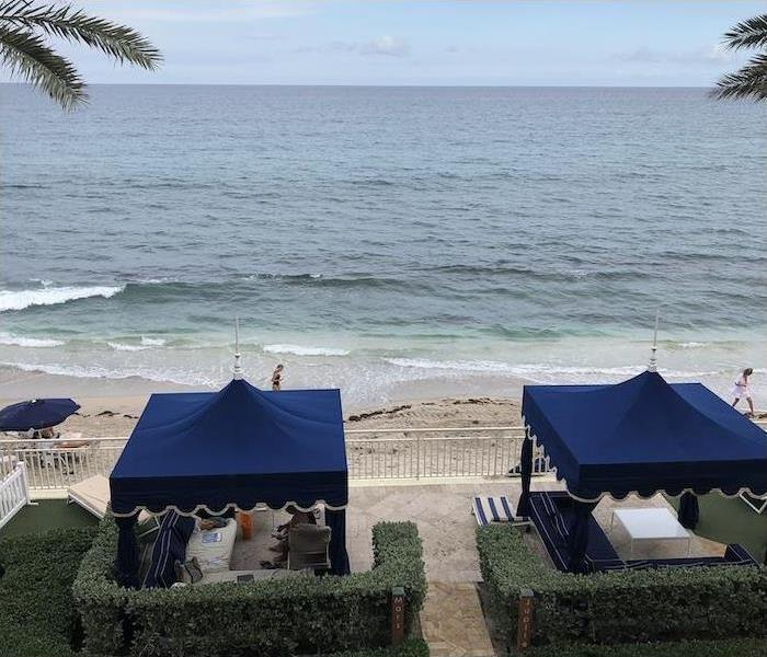 Atlantic Ocean and beach with two blue cabanas