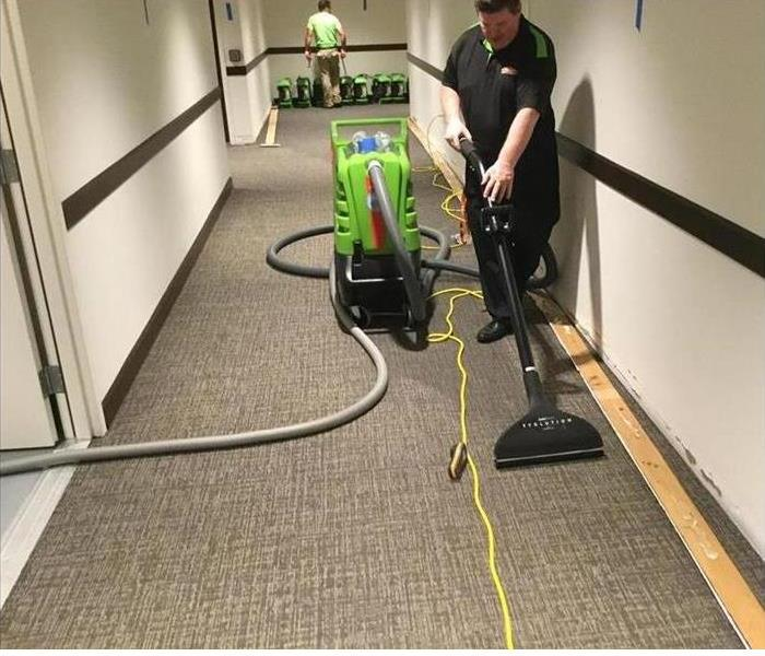 Our air movers working on the carpet and area around it in this building